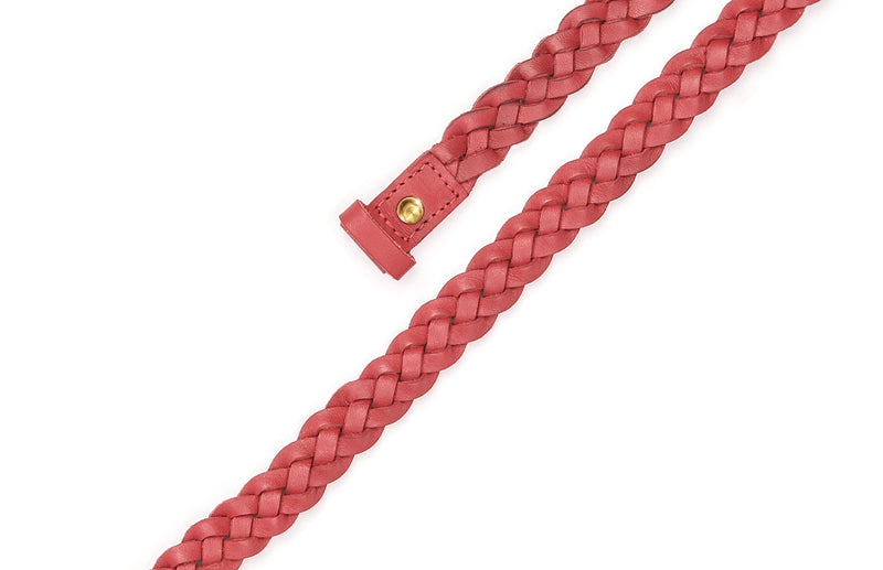 Top view of the hand braided Ivy women's leather belt in pomegranate / POMEGRANATE