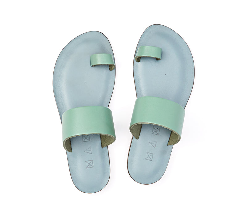 Top view of the handmade Root women's slip-on leather sandals in light grey insole with light green straps / GREEN
