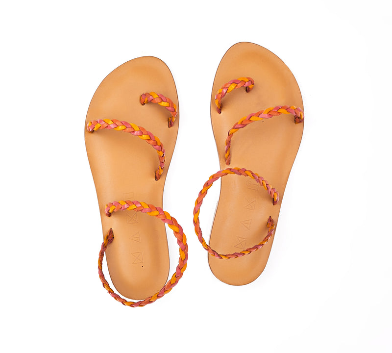 Top view of the handmade Salt women's braided slingback leather sandals in natural tan insole with pomegranate, orange and yellow straps / SUNSET