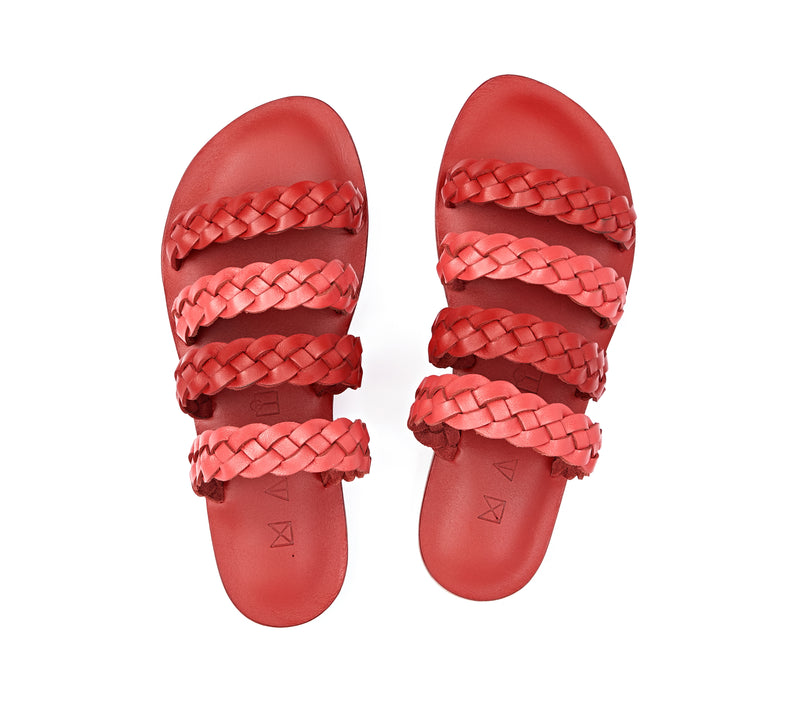 Top view of the handmade Sea women's braided slip-on leather sandals in red insole with pomegranate and red straps / RED POMEGRANATE
