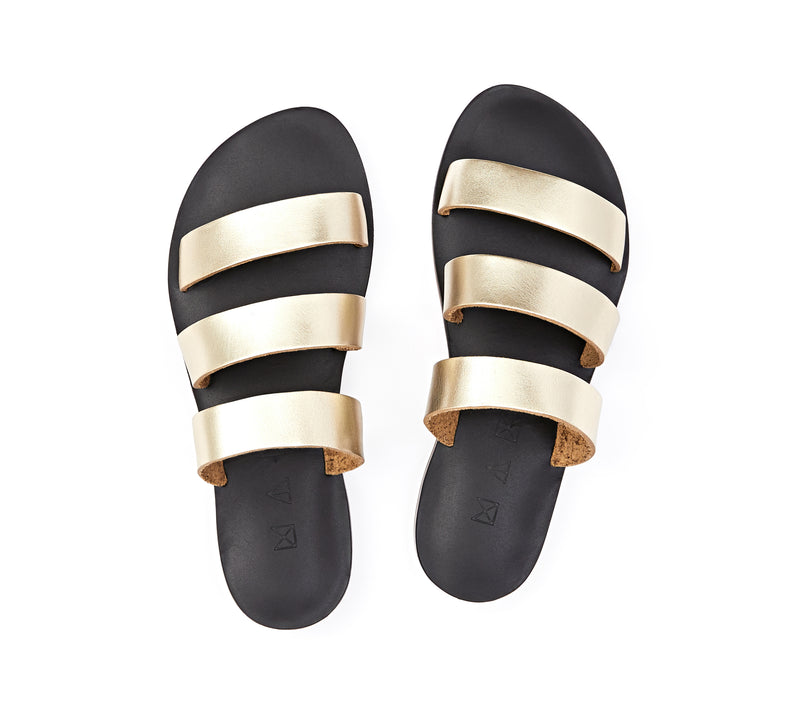 Top view of the handmade Sky women's slip-on leather sandals in black insole with gold straps / GOLD BLACK