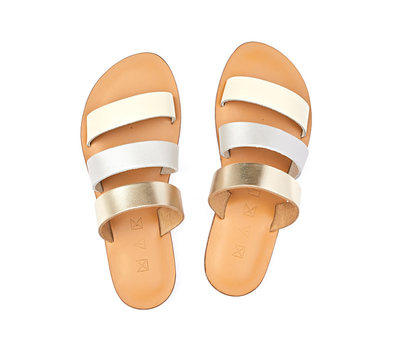 Top view of the handmade Sky women's slip-on leather sandals in natural tan insole with gold, silver and cream straps / MOONLIGHT