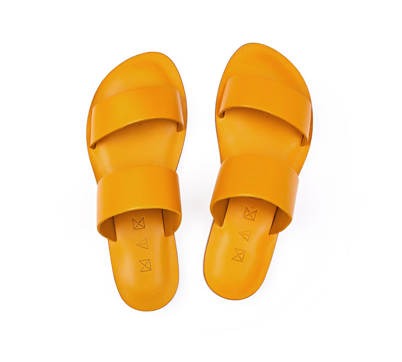 Top view of the handmade Sun women's slip-on leather sandals in yellow / YELLOW