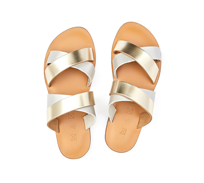 Top view of the handmade Wave women's slip-on leather sandals in natural tan insole with gold and silver straps / GOLD SILVER