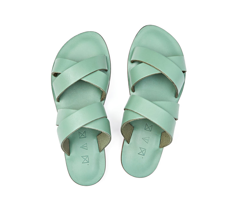 Top view of the handmade Wave women's slip-on leather sandals in light green / GREEN