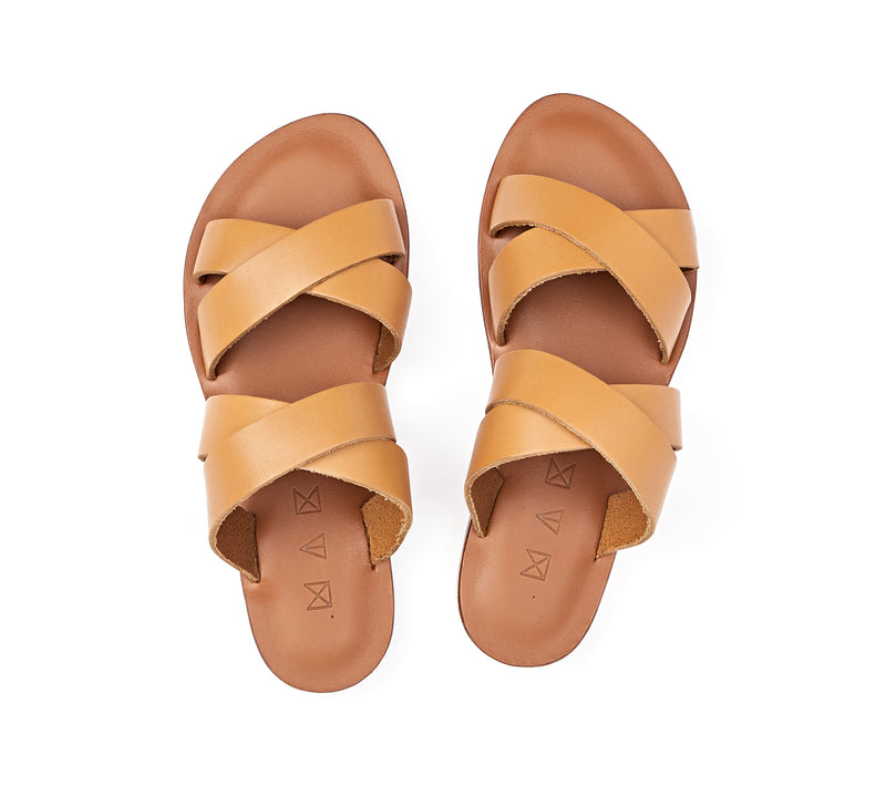 Top view of the handmade Wave women's slip-on leather sandals in light brown insole with natural tan straps / TAN