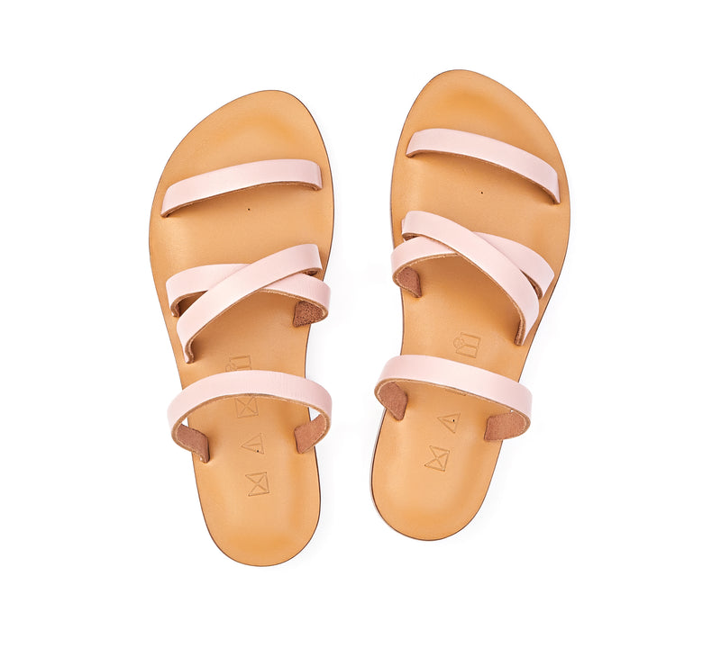 Top view of the handmade Wind women's slip-on leather sandals in natural tan insole with light pink straps / PINK