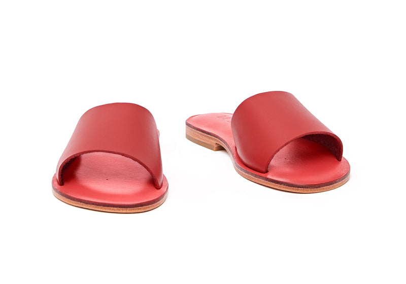 Front view of the handmade Rock women's slip-on leather sandals in pomegranate insole with  red straps / RED