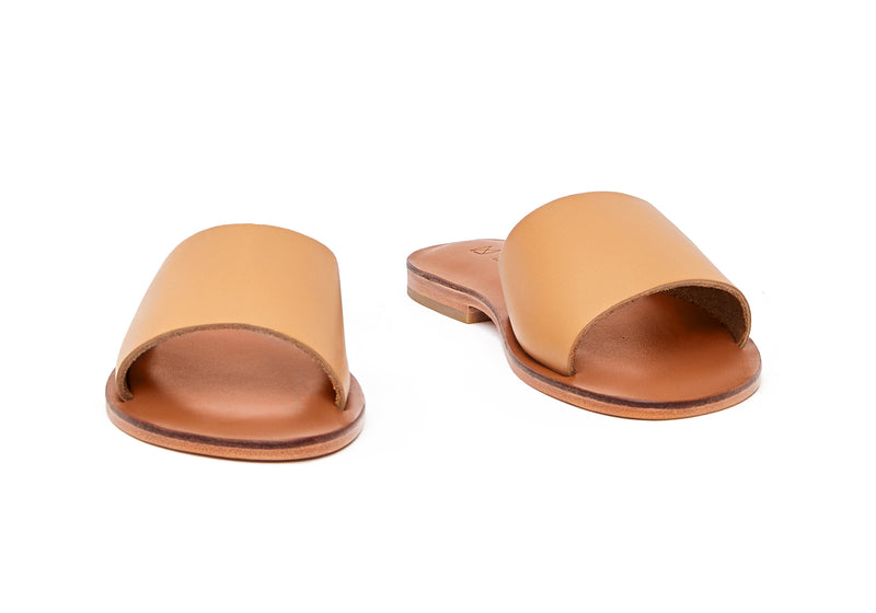 Front view of the handmade Rock women's slip-on leather sandals in light brown insole with natural tan straps / TAN