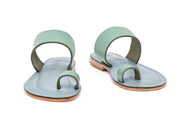 Front view of the handmade Root women's slip-on leather sandals in light grey insole with light green straps / GREEN
