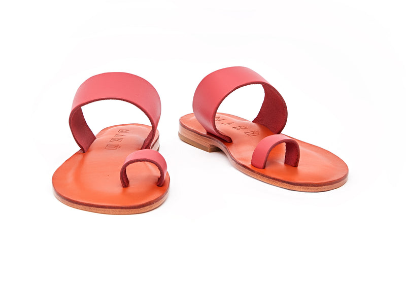 Front view of the handmade Root women's slip-on leather sandals in orange insole with pomegranate straps / POMEGRANATE