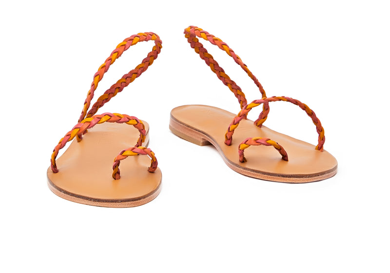 Front view of the handmade Salt women's braided slingback leather sandals in natural tan insole with pomegranate, orange and yellow straps / SUNSET