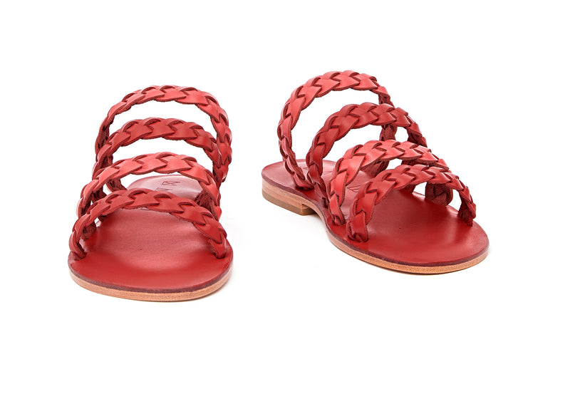 Front view of the handmade Sea women's braided slip-on leather sandals in red insole with pomegranate and red straps / RED POMEGRANATE