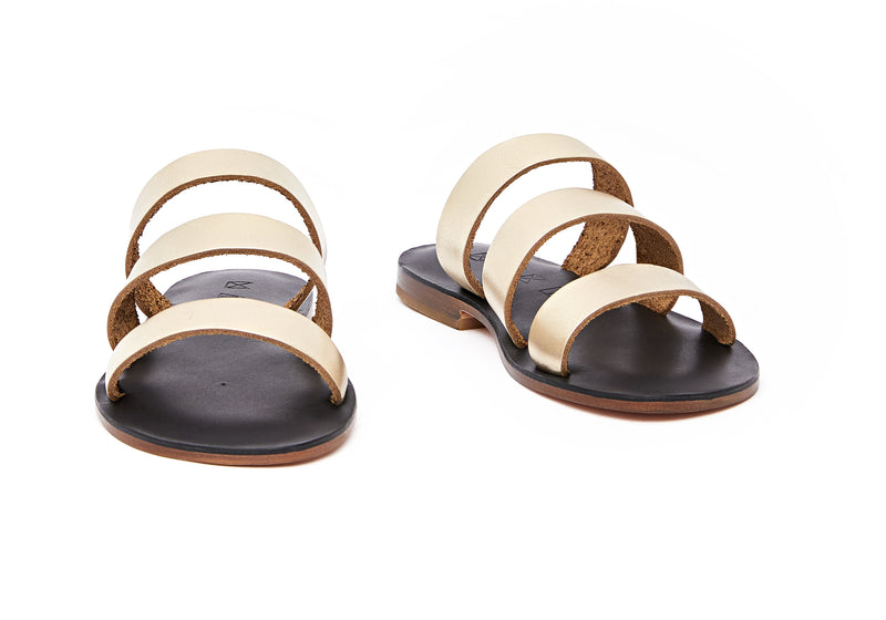Front view of the handmade Sky women's slip-on leather sandals in black insole with gold straps / GOLD BLACK