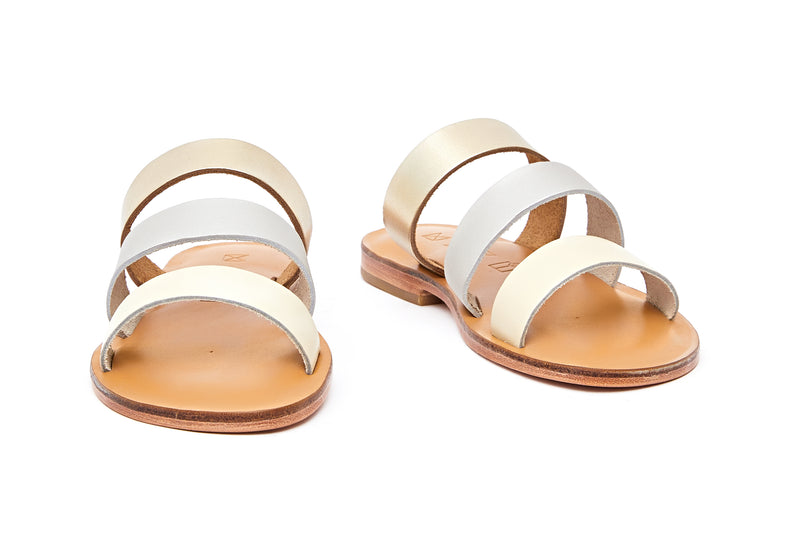 Front view of the handmade Sky women's slip-on leather sandals in natural tan insole with gold, silver and cream straps / MOONLIGHT