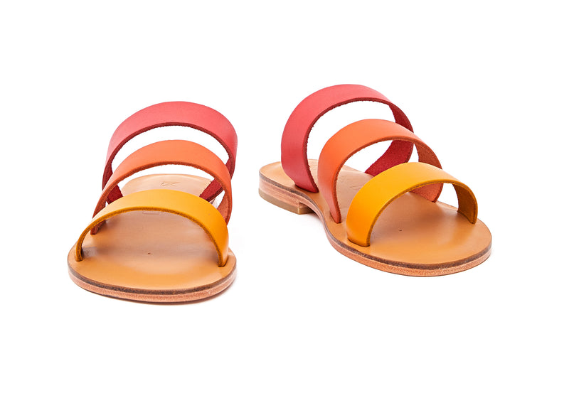Front view of the handmade Sky women's slip-on leather sandals in natural tan insole with pomegranate, orange and yellow straps / SUNSET
