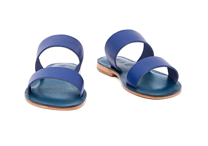 Front view of the handmade Sun women's slip-on leather sandals in night blue / BLUE