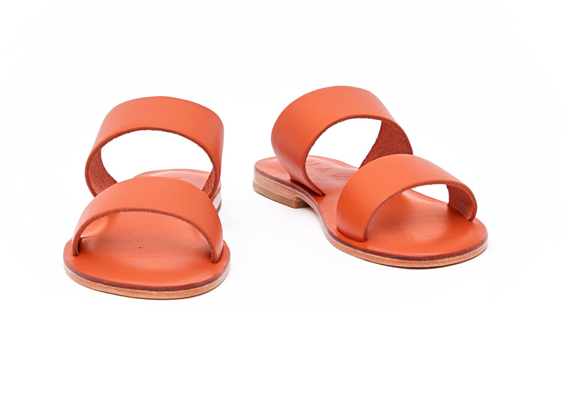 Front view of the handmade Sun women's slip-on leather sandals in orange / ORANGE