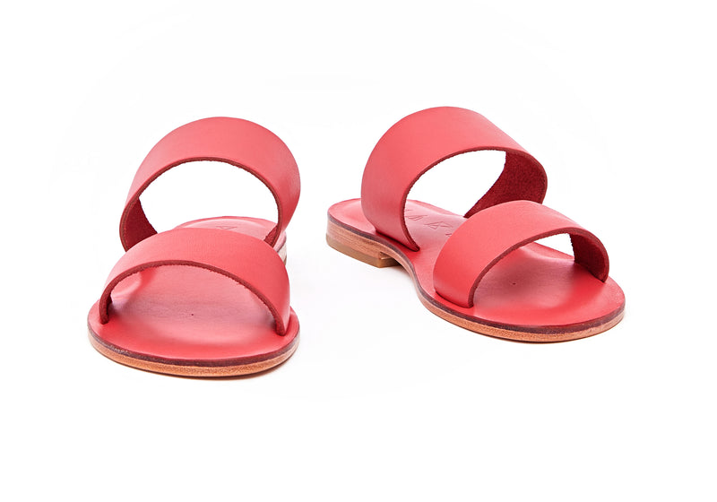 Front view of the handmade Sun women's slip-on leather sandals in pomegranate / POMEGRANATE