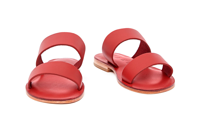 Front view of the handmade Sun women's slip-on leather sandals in red / RED