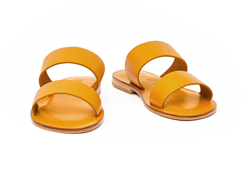 Front view of the handmade Sun women's slip-on leather sandals in yellow / YELLOW