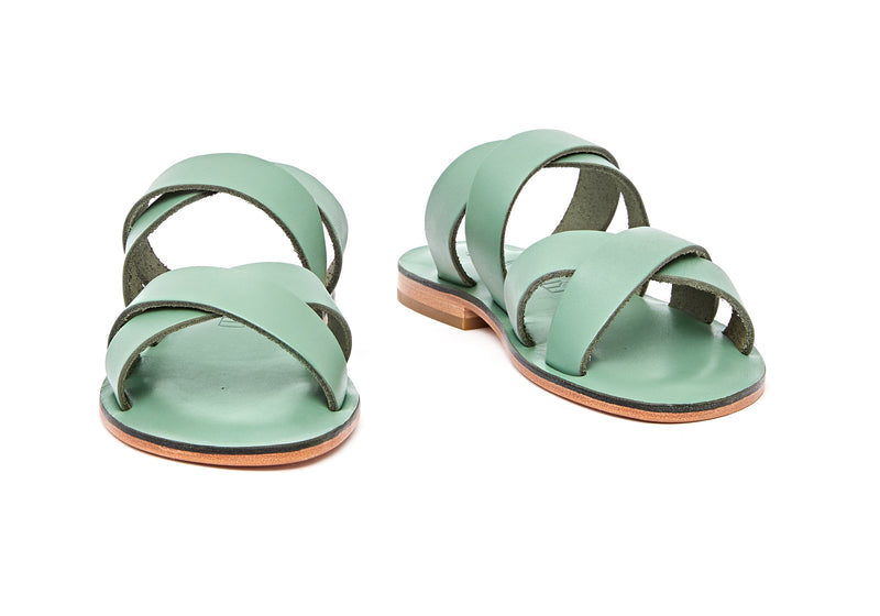 Front view of the handmade Wave women's slip-on leather sandals in light green / GREEN
