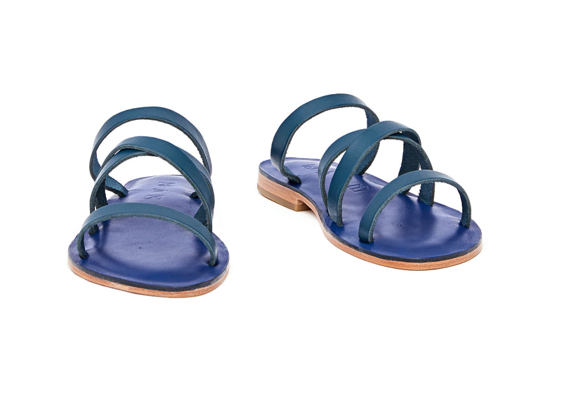 Front view of the handmade Wind women's slip-on leather sandals in night blue / MEDITERRANEAN
