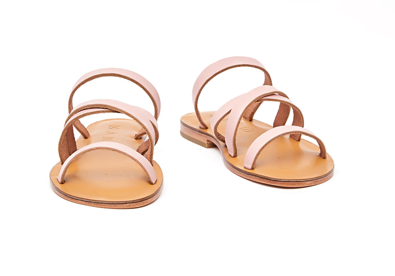 Front view of the handmade Wind women's slip-on leather sandals in natural tan insole with light pink straps / PINK