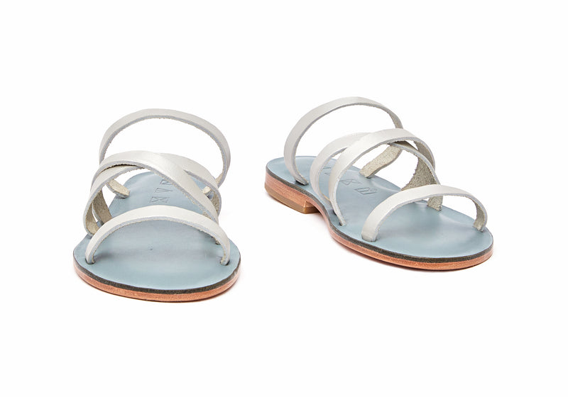 Front view of the handmade Wind women's slip-on leather sandals in light grey insole with silver straps / SILVER