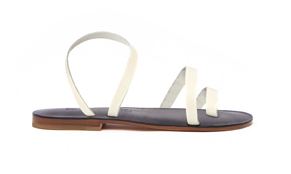 Side view of the handmade Moon women's slingback leather sandals in black insole with cream straps / CREAM BLACK