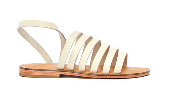 Side view of the handmade Ray women's slingback leather sandals in natural tan insole with cream straps / CREAM