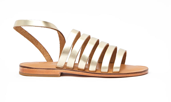 Side view of the handmade Ray women's slingback leather sandals in natural tan insole with gold straps / GOLD