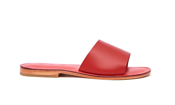 Side view of the handmade Rock women's slip-on leather sandals in pomegranate insole with red straps / RED