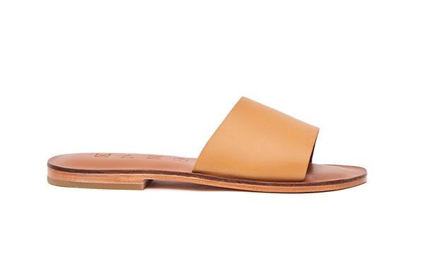 Side view of the handmade Rock women's slip-on leather sandals in light brown insole with natural tan straps / TAN