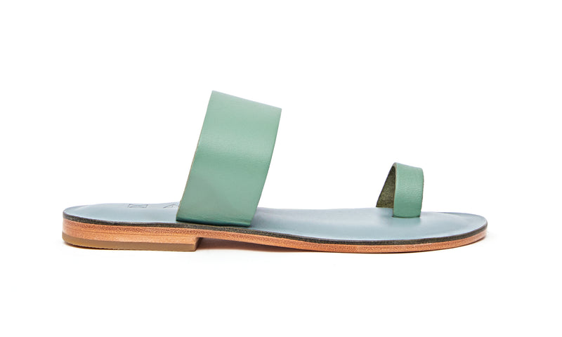 Side view of the handmade Root women's slip-on leather sandals in light grey insole with light green straps / GREEN
