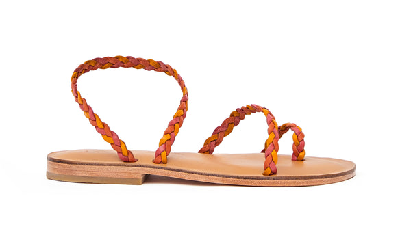Side view of the handmade Salt women's braided slingback leather sandals in natural tan insole with pomegranate, orange and yellow straps / SUNSET