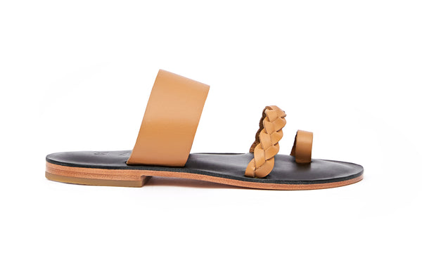 Side view of the handmade Sand women's braided slip-on leather sandals in black insole with natural tan straps / TAN BLACK
