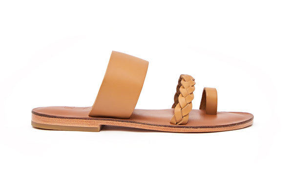 Side view of the handmade Sand women's braided slip-on leather sandals in light brown insole with natural tan straps / TAN