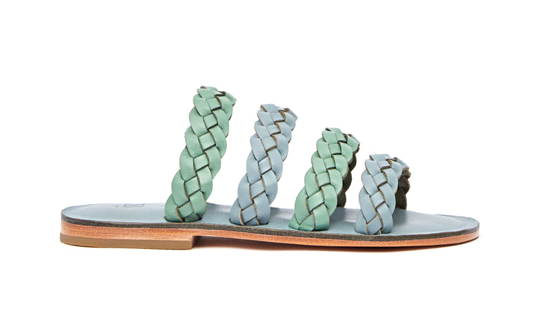 Side view of the handmade Sea women's braided slip-on leather sandals in light grey insole with light green and grey straps / GREY GREEN