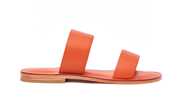 Side view of the handmade Sun women's slip-on leather sandals in orange / ORANGE