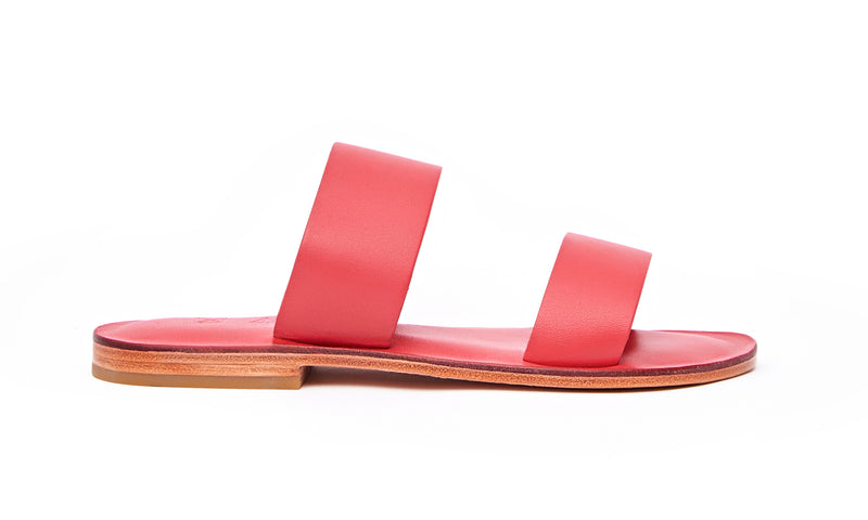 Side view of the handmade Sun women's slip-on leather sandals in pomegranate / POMEGRANATE