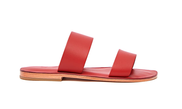 Side view of the handmade Sun women's slip-on leather sandals in red / RED