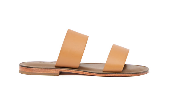 Side view of the handmade Sun women's slip-on leather sandals in olive insole with natural tan straps / TAN