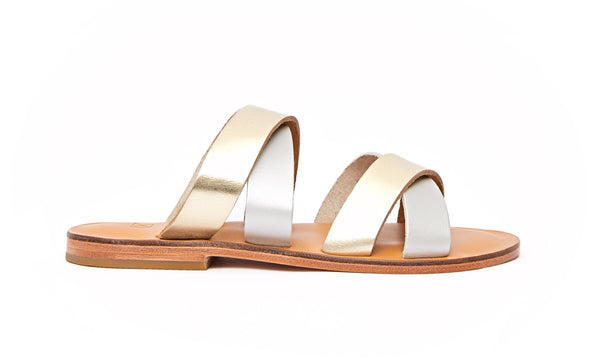 Side view of the handmade Wave women's slip-on leather sandals in natural tan insole with gold and silver straps / GOLD SILVER