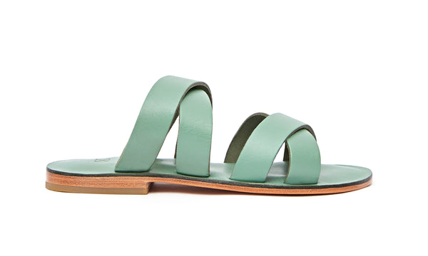 Side view of the handmade Wave women's slip-on leather sandals in light green / GREEN