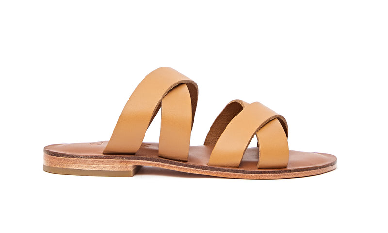 Side view of the handmade Wave women's slip-on leather sandals in light brown insole with natural tan straps / TAN