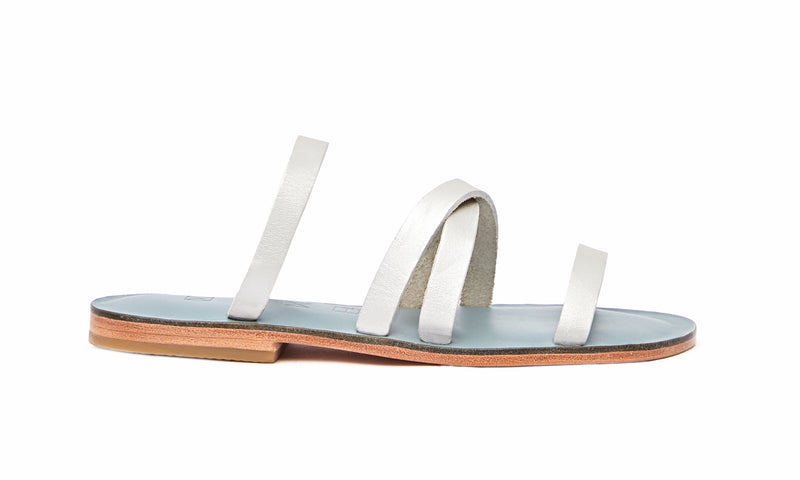 Side view of the handmade Wind women's slip-on leather sandals in light grey insole with silver straps / SILVER
