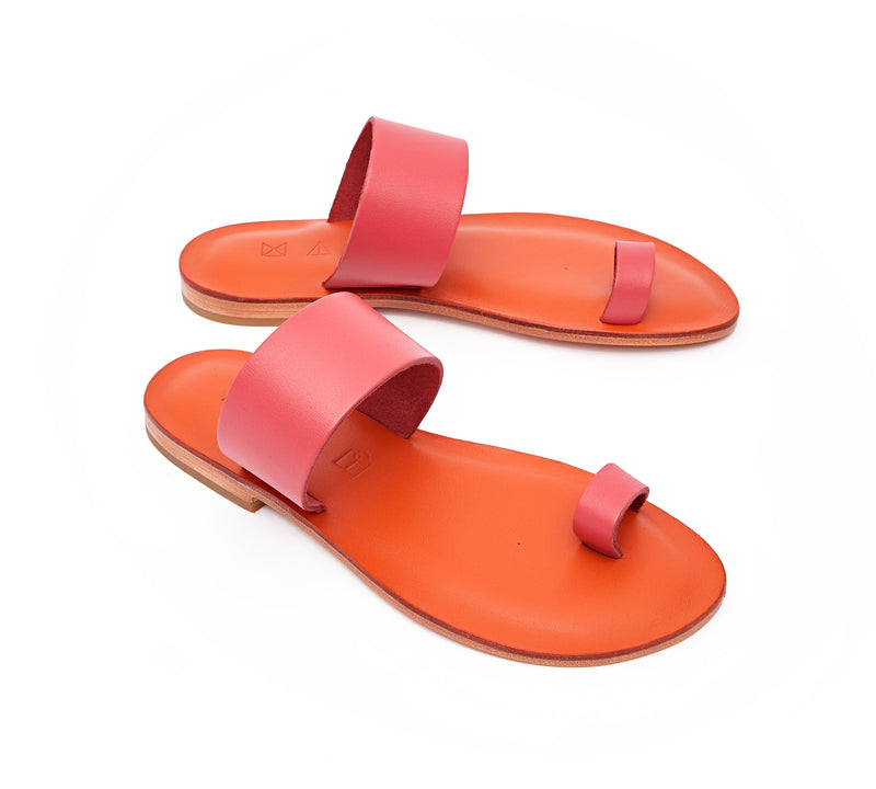 Angled view of the handmade Root women's slip-on leather sandals in orange insole with pomegranate straps /  POMEGRANATE