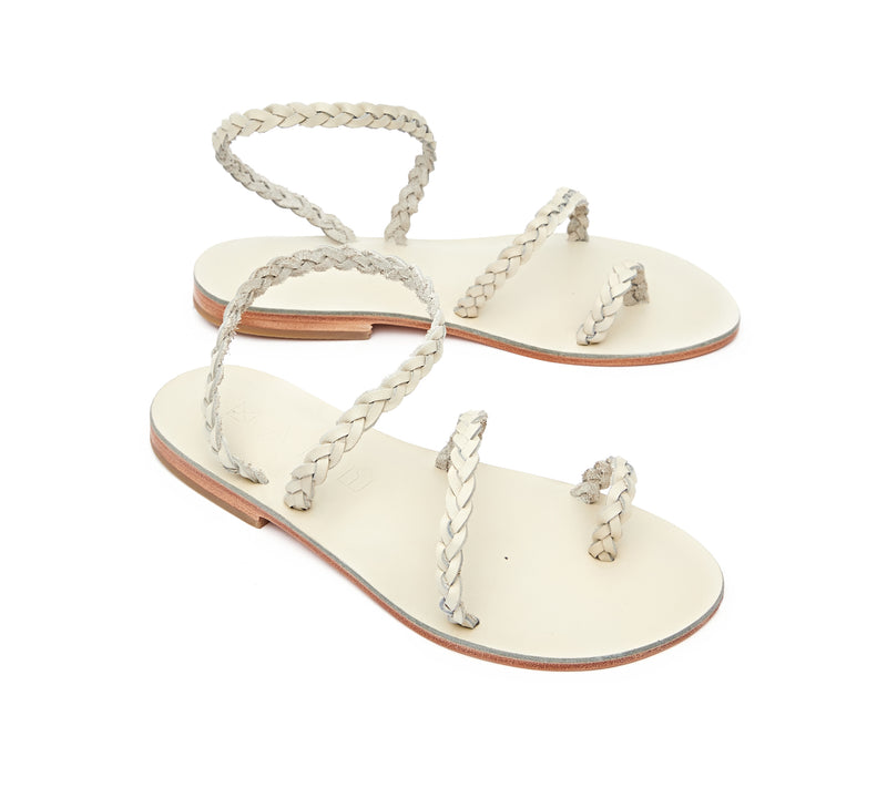 Angled view of the handmade Salt women's braided slingback leather sandals in cream / CREAM