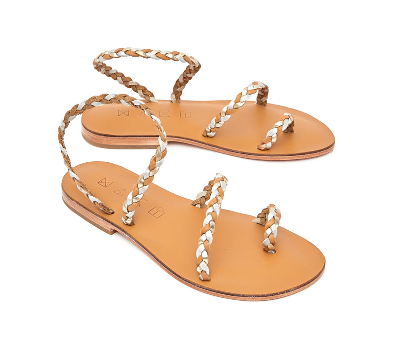 Angled view of the handmade Salt women's braided slingback leather sandals in natural tan insole with gold, silver and natural tan straps / GOLD SILVER